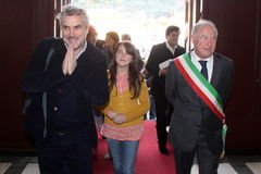 The oscar-winning alfonso Cuarón with dauther Bu. In the photo with her daughter Bu director and the mayor of Pietrasanta Domenico Lombardi. The oscar-winning royalty free stock photos