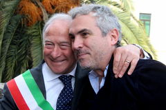 The oscar-winning director alfonso Cuarón. In the picture the director and the mayor of Pietrasanta Domenico Lombardi. The oscar-winning director Alfonso Cuar royalty free stock photos