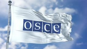 OSCE Waving Flag. Organization for Security and Co-operation in Europe OSCE flag waving against clear blue sky, close up, with clipping path mask luma channel stock illustration