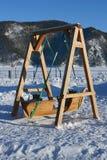 Oscilación de madera de los niños Fotografía de archivo
