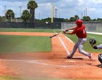 Oscilación del home run Imagenes de archivo