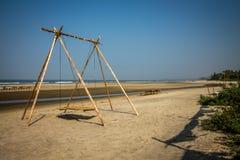 Oscilación en la playa Foto de archivo