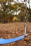 Oscilación en un parque Imagen de archivo libre de regalías