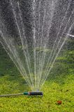 Oscillating garden sprinkler. Royalty Free Stock Image