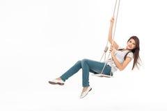 Oscillation de jeune femme photographie stock libre de droits