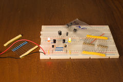 Oscillator circuit on prototyping board (breadboard) Royalty Free Stock Photo