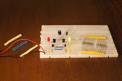 Oscillator circuit on prototyping board breadboard Stock Image