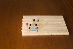 Oscillator circuit on prototyping board breadboard Stock Image
