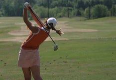 Oscillazione di golf della signora Immagine Stock