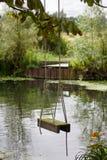 Oscillazione di legno della corda dal fiume Immagine Stock Libera da Diritti