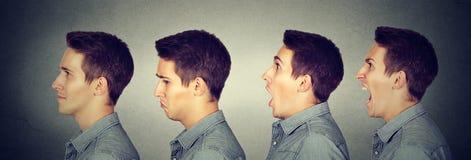 Oscillazione di umore Uomo con differenti espressioni del fronte di emozioni fotografia stock libera da diritti