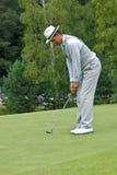 Oscillazione russa del giocatore di golf Immagini Stock