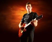 Oscilli il chitarrista Fotografia Stock Libera da Diritti