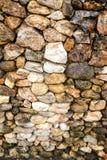 Oscilli la messa a fuoco selettiva di pietra del fondo di struttura al medio (profondità di campo bassa) riscaldano filtrato Fotografia Stock Libera da Diritti
