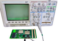 Oscilloscope and the board on a white background Royalty Free Stock Photo