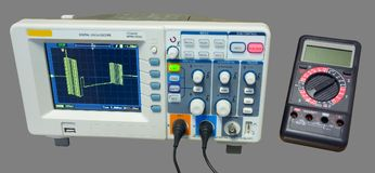Oscilloscope and multimeter. Measurement of data line signals royalty free stock photo