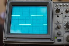 Oscilloscope signals a square wave on the display. instrument for measuring electrical signals in a circuit. tool for managing. Electronics and precision stock photo