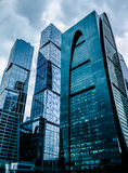 Oscow, Russia - September 24, 2016: Awesome modern glass skyscra. Pers in the Business centerrBlue skyscraper facade. office buildings. modern glass silhouettes Stock Photography