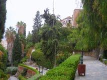Oscura Jardín-Málaga-España de Puerta Imágenes de archivo libres de regalías
