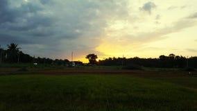 Oscuridad de la puesta del sol de la tarde Imagen de archivo