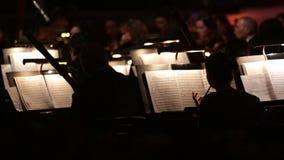 Oscuridad de la sinfonía de la orquesta almacen de metraje de vídeo