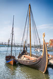 The Oseberg Viking Ship and her Copy in the fjord, Tonsberg, Norway. Tonsberg, Norway - July 24, 2016: The Oseberg Viking Ship and her Copy in the fjord stock photos