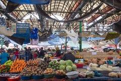 Osh Bazaar in Bishkek, Kyrgyzstan. Bishkek, Kyrgyzstan - October 2, 2014: Photograph of the indoor market called Osh Bazar Royalty Free Stock Images