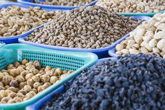 Osh bazaar in Kyrgyzstan - nuts and raisins for sale. Royalty Free Stock Image