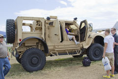 Oshkosh Humvee side view. OSHKOSH, WI - JULY 27: Side view of an Oshkosh Corp Humvee vehicle as used in the military on display the 2012 AirVenture at EAA on stock photography