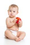Osiem miesięcy dziecka stary obsiadanie z jabłkiem Obrazy Stock
