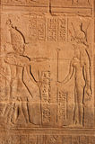 Osiris and Isis. Hieroglyphic carving on the wall of the Temple of Isis at Philae, Aswan, Egypt stock images