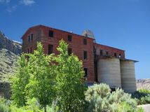 Osiris, Utah Ghost Town. Originally built as a creamery, this large wood and rock structure was later converted to a grain processing plant.  It now stands Stock Photos