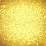 Oskarp guld- gnistrandetextur Guld- abstrakta Bokeh blänker backg fotografering för bildbyråer