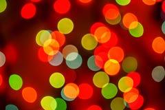 Oskarpa ljus för mångfärgad defocused bokeh, julljus, fe arkivfoto