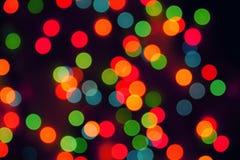 Oskarpa ljus för mångfärgad defocused bokeh, julljus, fe fotografering för bildbyråer