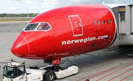 OSLO - AUG. 13: Norwegian Air Boeing Dreamliner 787 plane parked at Oslo Gardermoen airport on August 13, 2014. Expanding destinations low cost transatlantic royalty free stock photo