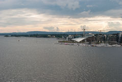 Oslo bay. The view from the hill on the Oslo bay with ships and boats on the pier in the evening Stock Photos