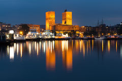 Oslo City Hall in the night with the reflection in the glossy water Stock Images