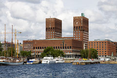 The Oslo City Hall in Norway, view from the bay Pipervika. The Oslo City Hall is house of the city council and city administration. The house was built in 1950 royalty free stock photos
