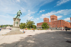 Oslo City Hall square. OSLO, NORWAY - AUGUST 13: Square with Oslo City Hall on August 13, 2012. Construction started in 1931, but was paused by the outbreak of royalty free stock photo