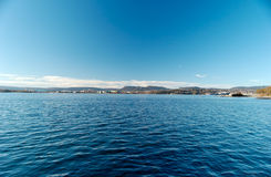 Oslo Fjord. Fish-eye view over Oslo Fjord, looking at Bygøy and Fornebu. Sky and water are filter-polarised Royalty Free Stock Images