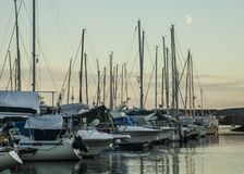 Oslo - the fjord - boats and the moon. Royalty Free Stock Photography