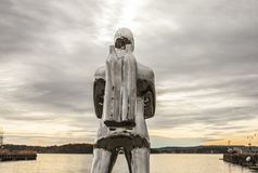 Oslo-fjord at sunset, a diver. This image shows a view of the Oslo-fjord at sunset. There`s a statue of a diver visible in the middle of the picture Royalty Free Stock Photo
