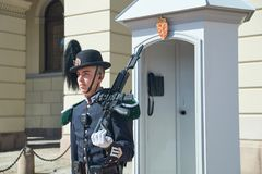 Guardsman, member of Hans Majestet Kongens Garde HMKG, on sentry duty at the Royal Palace in Oslo, Norway. Oslo, Norway: April 26 2017 - Guardsman, member of Royalty Free Stock Images