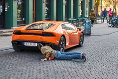 Orange Lamborghini Huracan LP 580-2 Spyder car released circa 2016 in Italy parked on the street causing a great stock images