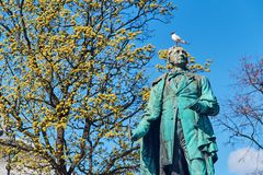 View of the monument to Henrik Wergeland on Eidsvolls plass Spikersuppa near the National Theater in Oslo, Norway stock images