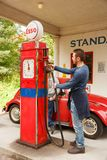 Old gas station. Oslo, Norway-August 13, 2014 - Norwegian Museum of Cultural History. Standard Oil gas station of 1928 relocated from Holmestrand, vintage car stock photo