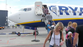 OSLO - NORWAY, AUGUST 2015: people taking plane, climbing stairs stock video footage
