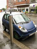 Oslo, Norway -06.24.2012: blue electric car charging royalty free stock photo