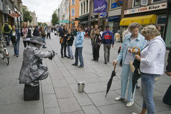 Oslo Norway. City centre mime artist and tourists royalty free stock photography